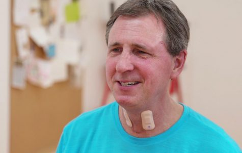 A man wears throat sensors designed by McCormick and Feinberg Prof. John Rogers' lab, in partnership with the Shirley Ryan AbilityLab.
