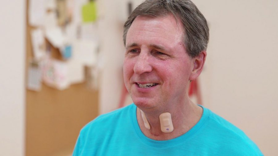 A+man+wears+throat+sensors+designed+by+McCormick+and+Feinberg+Prof.+John+Rogers%E2%80%99+lab%2C+in+partnership+with+the+Shirley+Ryan+AbilityLab.+