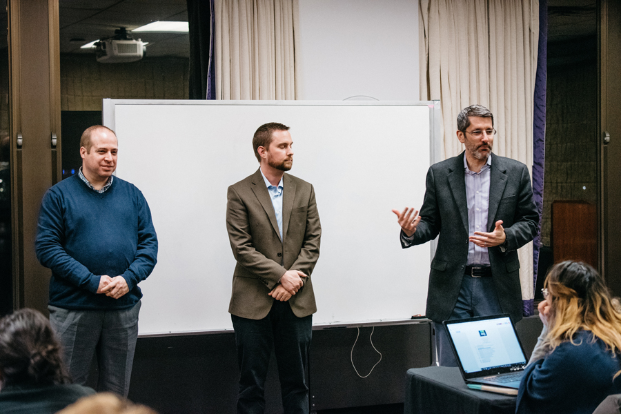 Brad Zakarin, Tim DeBold and Paul Hubinsky — members of the Undergraduate Residential Experience Committee — discuss the housing report with Associated Student Government senators Wednesday. Senators also elected two new vice presidents during their meeting.