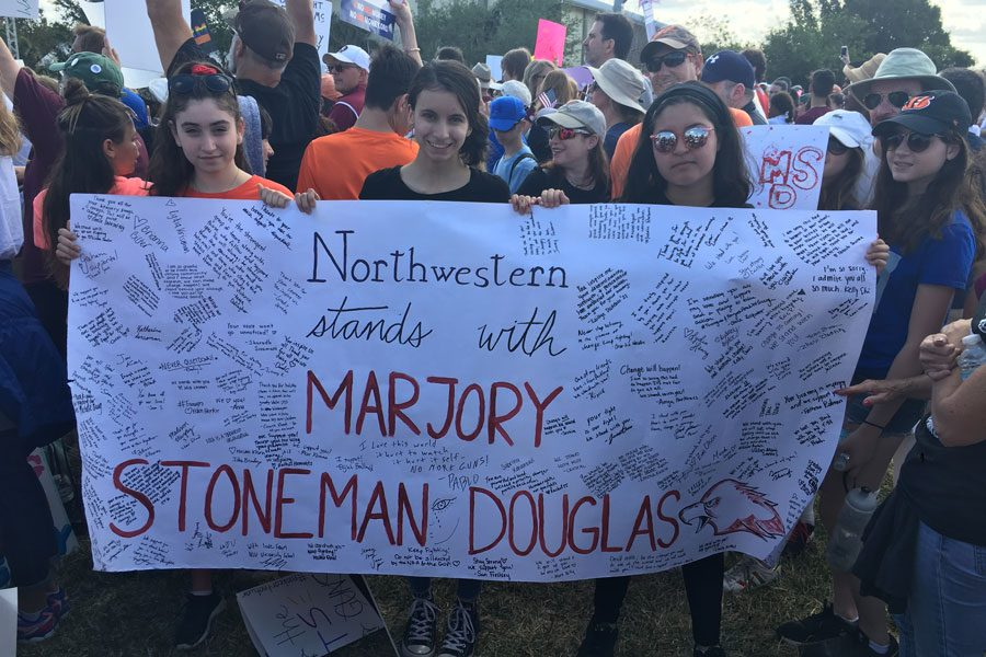 Northwestern+students+Farrah+Sklar+%28left%29%2C+Maddie+Gaines+%28center%29+and+Valen-Marie+Santos%2C+who+helped+organize+Northwestern+Stands+With+Marjory+Stoneman+Douglas%2C+attend+the+March+for+our+Lives+event+in+Parkland%2C+Florida.+Several+NU+students+participated+in+marches+across+the+country+on+Saturday+to+protest+gun+violence+in+the+wake+of+the+Feb.+14+shooting+in+Parkland.