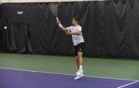 Michael Lorenzini follows through on a forehand. The junior and the Wildcats open conference play this weekend.