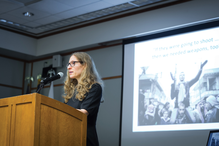 Political science Prof. Wendy Pearlman speaks about her book at an October event. Pearlman recently published accounts of Syrians living through violence in Ghouta in the international cover story for Time magazine.