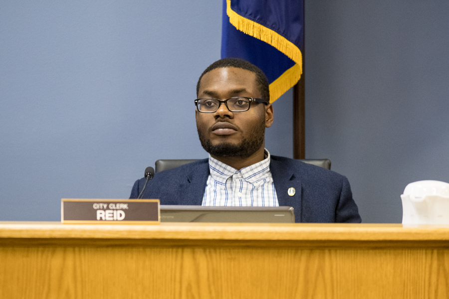 City clerk Devon Reid at a City Council meeting. Reid appeared in court on Tuesday after his arrest for driving on a suspended license in February.