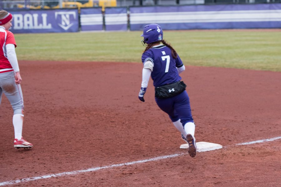 Morgan Nelson rounds first base. The junior and the Wildcats are set for five games in three days this weekend.