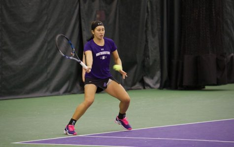 Lee Or slices a forehand. The junior helped the Wildcats extend their winning streak to five matches this weekend.