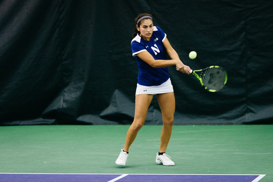 Caroline+Pozo+prepares+to+hit+a+backhand.+The+Wildcats+look+to+win+their+second+straight+game+against+a+top-10+opponent.