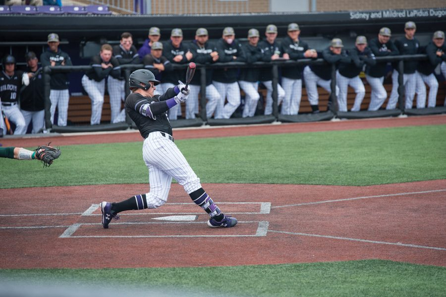 Willie Bourbon takes a swing. The junior first baseman tallied 3 RBIs on Sunday, but the Wildcats still lost to the Spartans, 6-5.