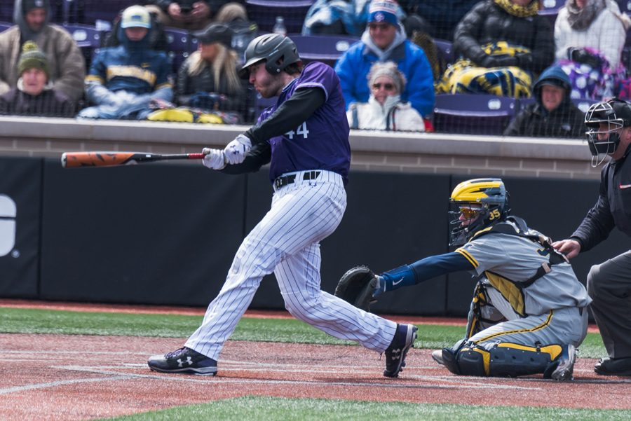 Jack+Claeys+takes+a+swing.+The+senior+catcher+extended+his+hitting+streak+to+five+games+this+weekend+even+though+Northwestern+was+swept+by+Indiana.