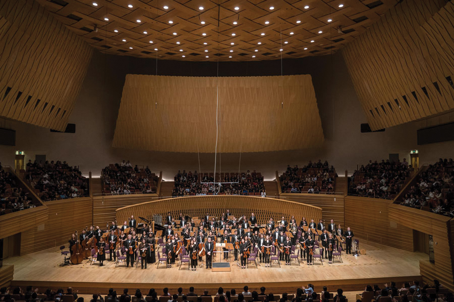 "The Northwestern University Symphony Orchestra stands following their performance of Bernstein's ""Symphonic Dances."" NUSO returned from its 10-day Asia tour on Sunday."