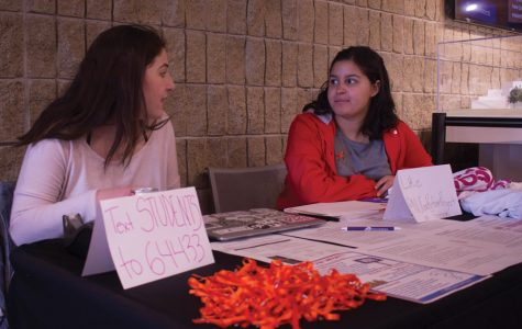 Medill senior Stephanie Bernstein (left) and Communication freshman Valen-Marie Santos sit at a table in Norris University Center. The students are part of the Northwestern Gun Reform Project, which held events Friday to honor the victims of the Columbine shooting.