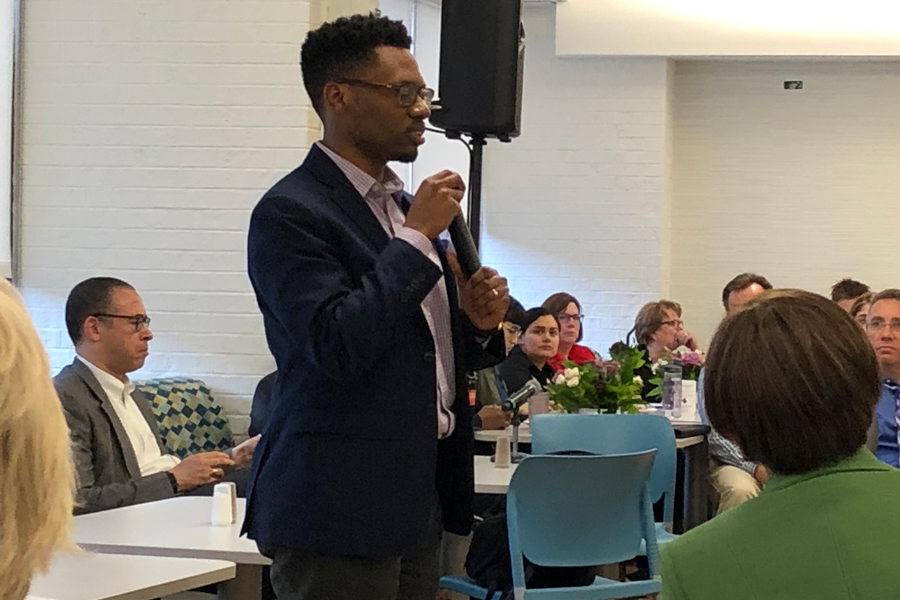 Director of Social Justice Education Robert Brown speaks at Foster-Walker Complex. Brown facilitated conversation at the community dialogue, a quarterly event in which administrators address student questions.