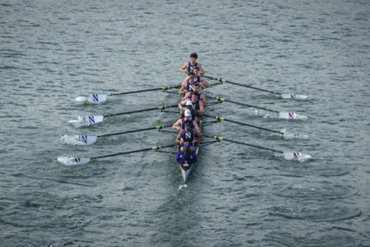 """Northwestern Crew team members row in a competition. The team will head to China later this month for the """"Rowing in Henan"""" Zhengzhou International University Rowing Regatta."""