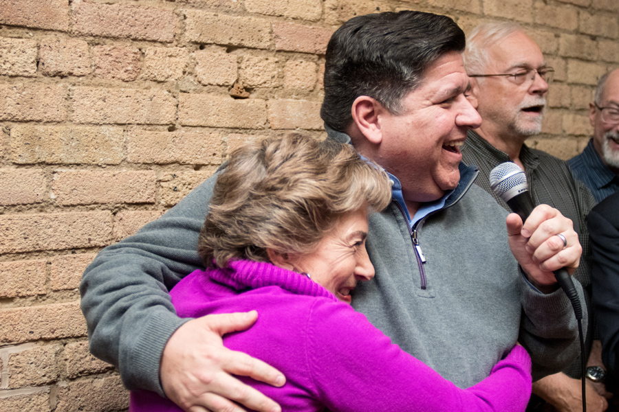 Democratic gubernatorial candidate J.B. Pritzker pulls U.S. Rep. Jan Schakowsky (D-Ill.) into a hug at a meet and greet Saturday. Pritzker and Schakowsky spoke about the importance of voting in November and defeating incumbent Gov. Bruce Rauner.