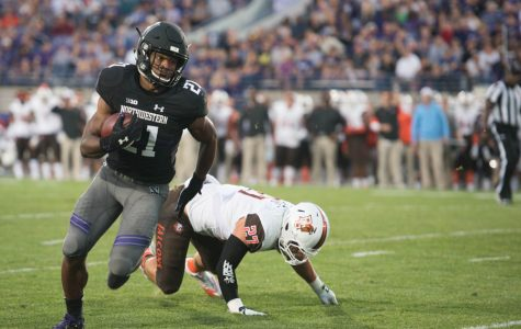 Justin Jackson runs past a Bowling Green defender. The accomplished Northwestern running back was chosen in the seventh round of the NFL Draft on Saturday.