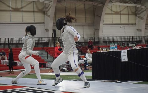 A Northwestern fencer dodges an attack. Eight NU fencers will compete in this weekend's Division I National Championships.