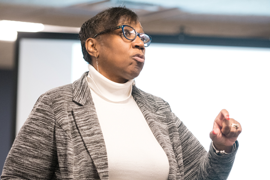Evanston's equity and empowerment coordinator Patricia Efiom speaks at a 5th Ward meeting on Thursday. Efiom spoke about equity's role in the priority-based budgeting that Evanston will work on in preparation for the upcoming budget deficit.