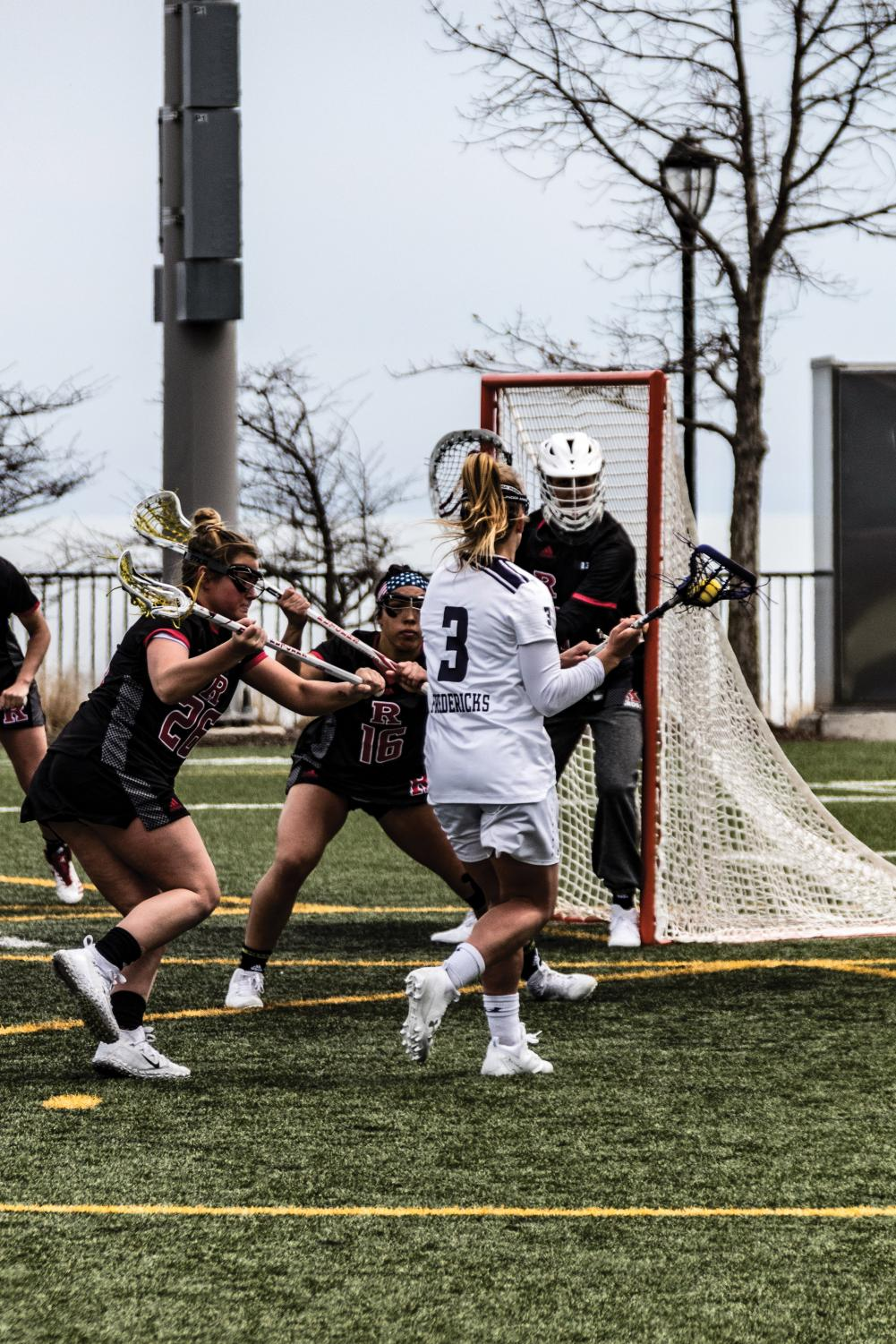 Shelby Fredericks eyes the Rutgers defense. The senior attacker registered nine assists, falling one short of the program record, in Northwestern's 19-7 win Saturday.