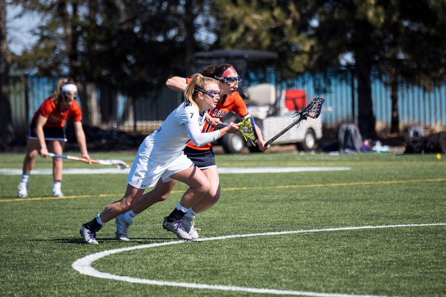 Sheila Nesselbush races for a ball alongside a defender. The senior midfielder has tallied 16 points during the Wildcats' four-game winning streak.