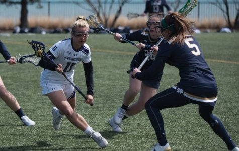 Ally Palermo evades two Notre Dame defenders. The freshman midfielder tallied a brilliant assist after a long run through the midfield, helping to spark Northwestern's 20-10 win.