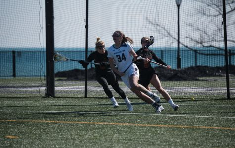 Holly Korn holds off two defenders. The 6-foot-2 attacker's size and quick hands have helped her tally 15 goals so far this year.