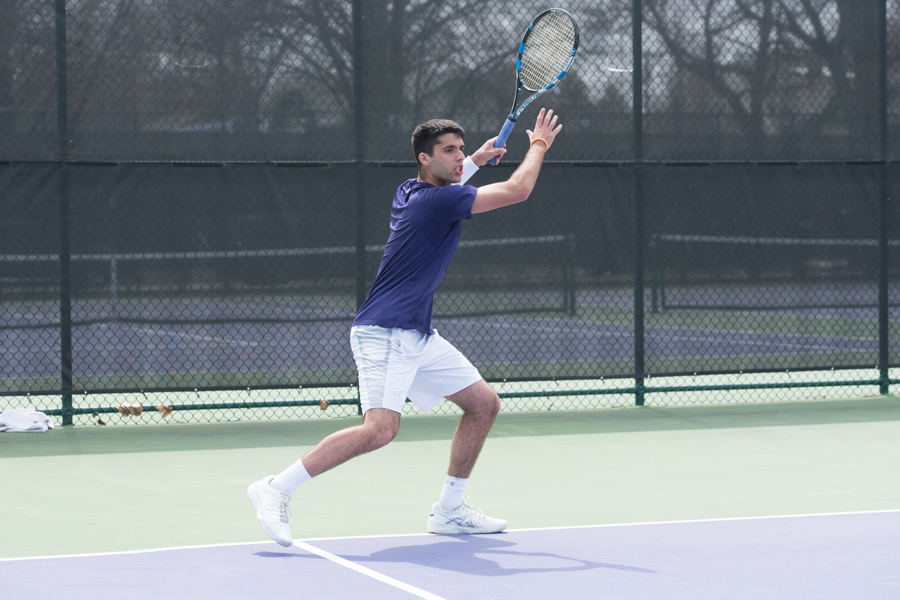 Jason Seidman hits a forehand. The junior collected one win this weekend at NU's final home matches against Minnesota and Wisconsin.