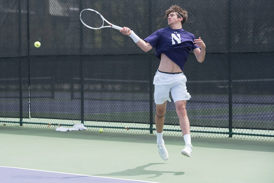 Nick+Brookes+follows+through+on+a+forehand.+The+freshman+was+one+of+two+victors+Thursday.+