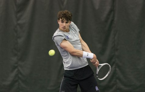 Nick Brookes hits a backhand. The freshman won his singles match Friday against Michigan State in straight sets.