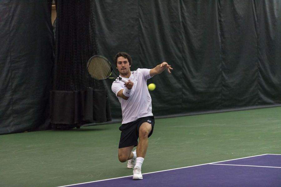 Antonioni+Fasano+hits+a+shot.+The+freshman+rallied+to+win+his+singles+match+on+Wednesday%2C+giving+Northwestern+a+dramatic+win+at+Purdue.