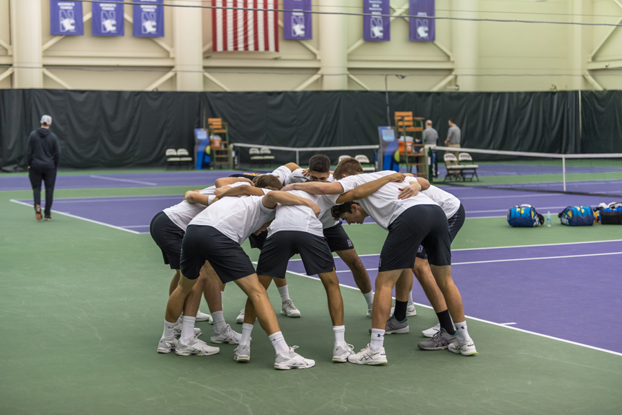 Northwestern huddles prior to the start of a match. The Wildcats, currently led by associate head coach Chris Klingemann, have won three of six matches since coach Arvid Swan's absence began.