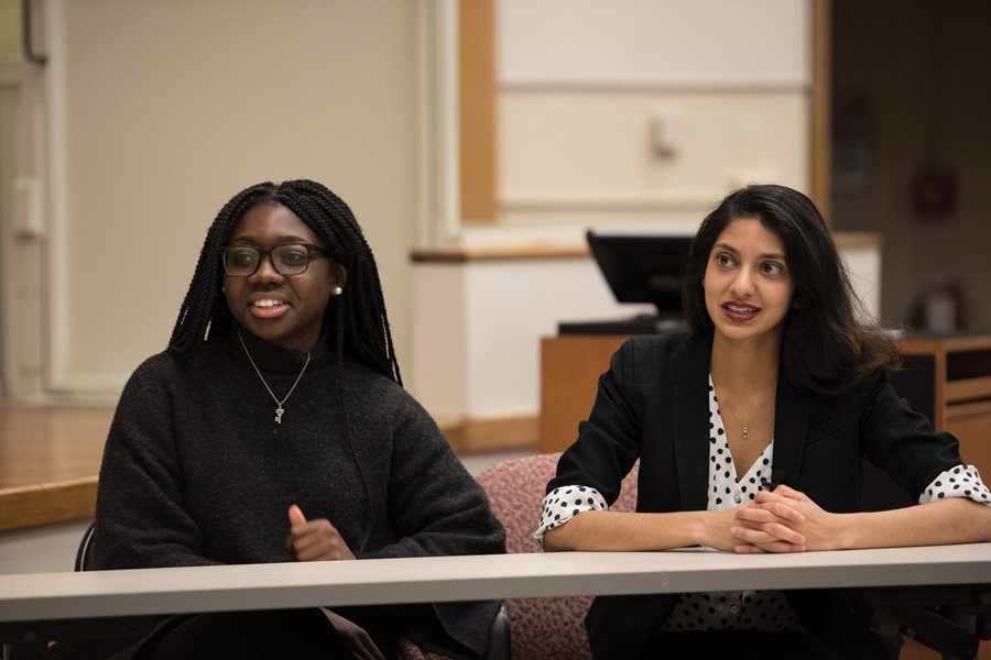 Then-Weinberg juniors Nehaarika Mulukutla (right) and Rosalie Gambrah speak during a Daily-moderated debate in April 2017. The two will complete their term as Associated Student Government president and executive vice president next week.