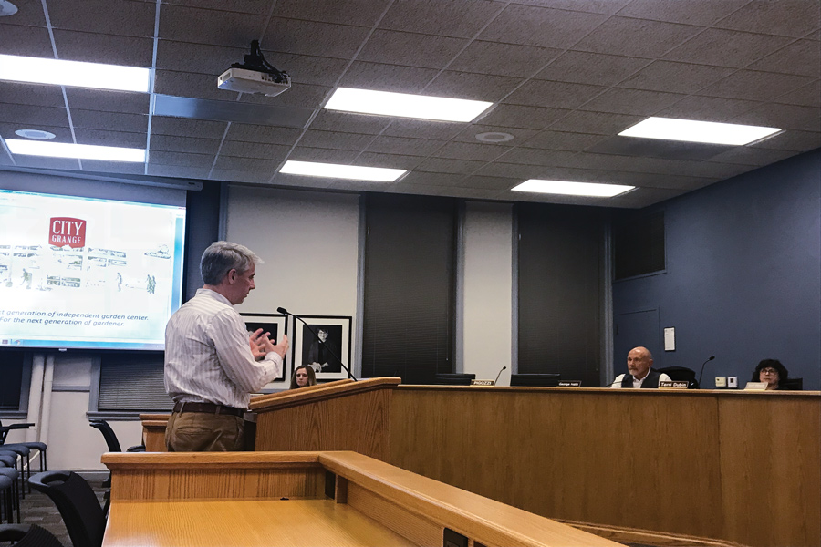 David Brown, president of Harrington Brown, LLC, speaks at a Plan Commission meeting Wednesday. The commission voted 5-1 to recommend City Council's approval for a building at 128-132 Chicago Ave.