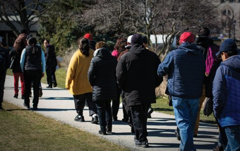 Roughly 70 workers march amid concerns about food provider change