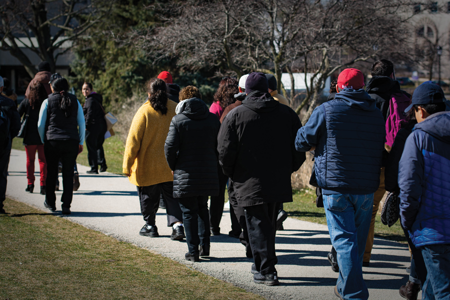 Northwestern's Sodexo and Aramark employees march Friday to present a petition asking the companies to help with the transition to Compass Group North America. The demonstrators raised concerns about possible drug tests, background checks and participation in the E-verify program.