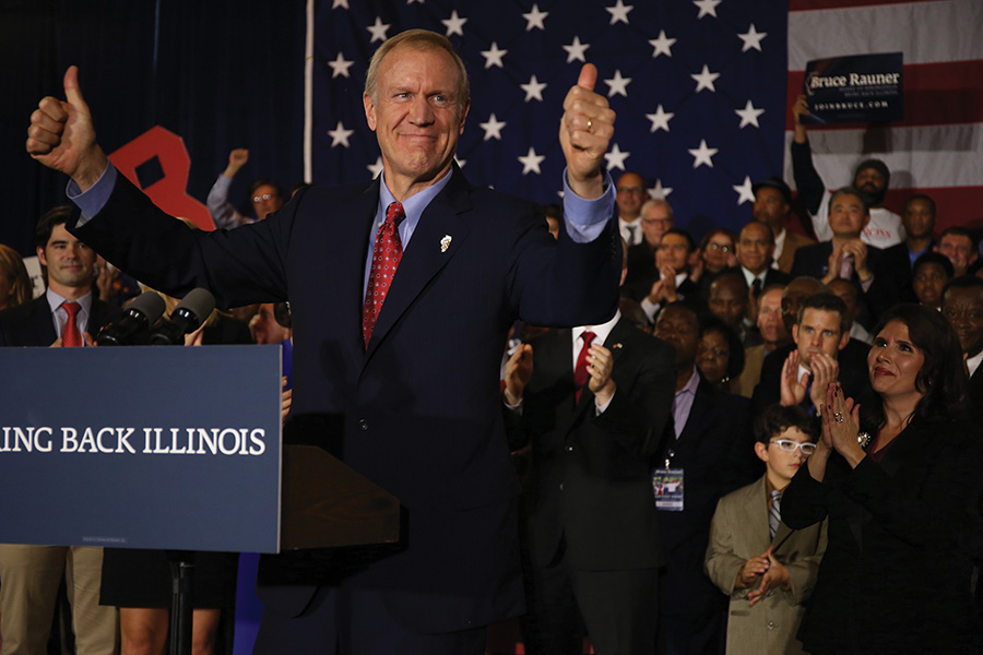 Gov. Bruce Rauner declares victory on election night in 2014. Rauner left Friday for a trip to Europe focused on jobs.