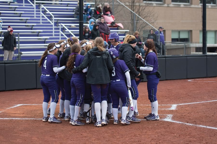 Northwestern huddles between innings. The Wildcats will travel to South Bend, Indiana, for an important nonconference game against Notre Dame on Wednesday.