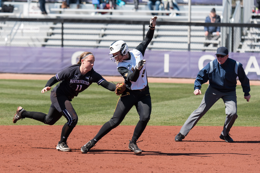 Freshman second baseman Rachel Lewis tags out Iowa's Sarah Kurtz on the basepaths. A strong defensive effort helped Northwestern top the Hawkeyes 6-2.