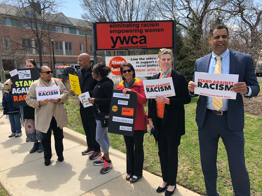 Community members stand on the corner of Ridge Avenue and Church Street at the Evanston/North Shore YWCA. They joined more than 10,000 people on the North Shore to participate in the YWCA's annual Stand Against Racism event.