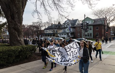 Students march from The Rock to Norris University Center in April for Take Back the Night. The event was held to raise awareness around sexual assault and provide support for survivors on campus.