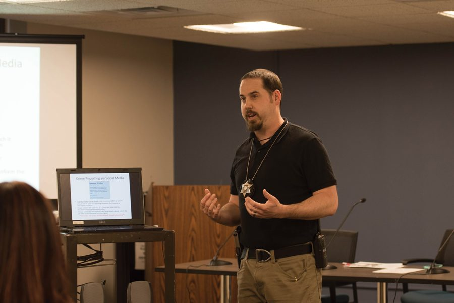 Detective Christopher Tortorello speaks at an Evanston Police Department town hall Thursday. Police answered residents' questions about social media and community relationships.