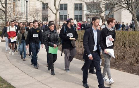 Students walk through campus for the annual Walk to Remember. The Thursday event was hosted by Alpha Epsilon Pi in honor of Holocaust Remembrance Day.