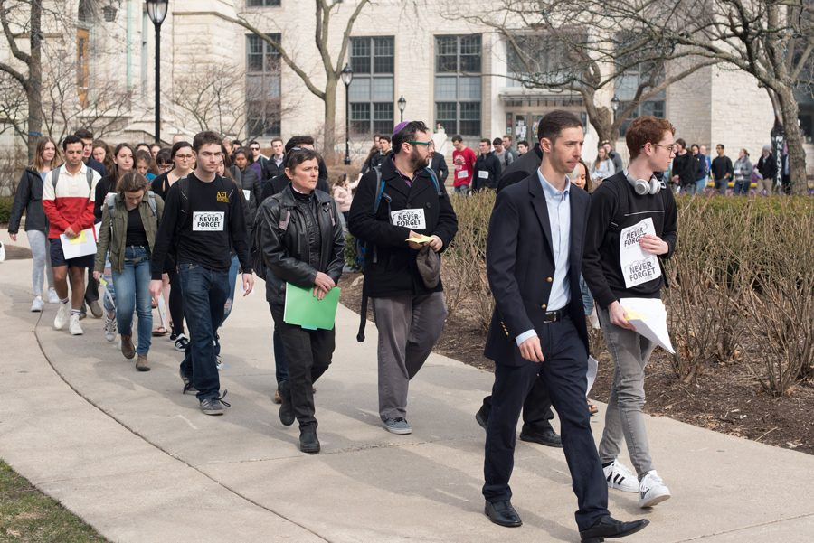 Students+walk+through+campus+for+the+annual+Walk+to+Remember.+The+Thursday+event+was+hosted+by+Alpha+Epsilon+Pi+in+honor+of+Holocaust+Remembrance+Day.+%0A