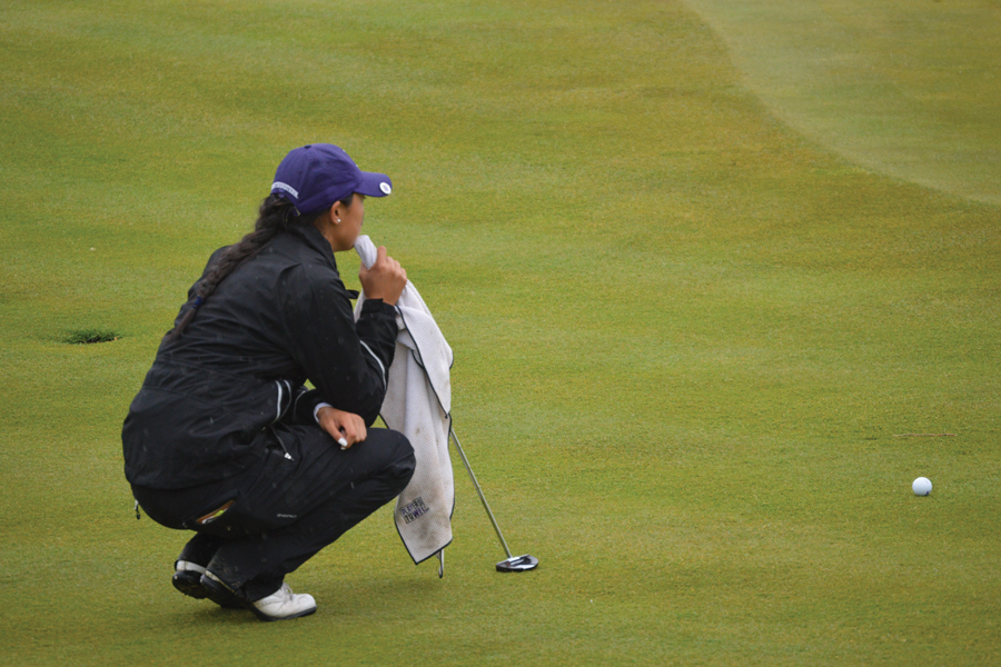 Janet Mao analyzes a putt. Mao led a great Sunday outing for the Cats, salvaging an otherwise lackluster Big Ten Tournament showing.