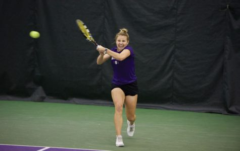 Alex Chatt hits a return. The senior dramatically won Northwestern's Sunday match at Michigan in a third-set tiebreaker.