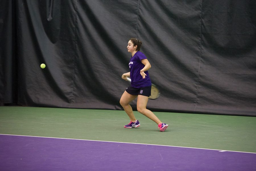 Inci+Ogut+swings+at+the+ball.+The+freshman+has+won+eight+of+12+singles+matches+this+season%2C+helping+Northwestern+climb+to+No.+13+as+a+team.