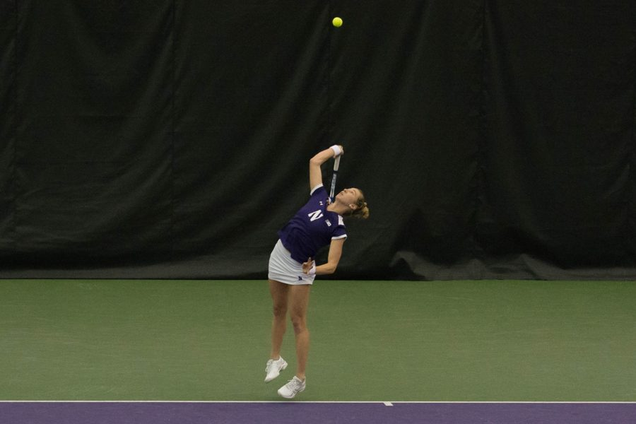 Maddie+Lipp+prepares+to+serve.+The+Wildcats+fell+to+Michigan+in+the+Big+Ten+Tournament+championship+match.