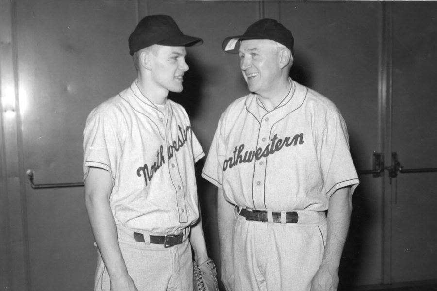 """Chuck Lindstrom (left) and Fred Lindstrom (right) chat during a preseason workout. Chuck said his father was a """"fantastic"""" coach."""