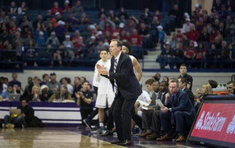 Chris Collins coaches from the bench. On Monday, he added a new coach to his staff to help lead Northwestern next season.
