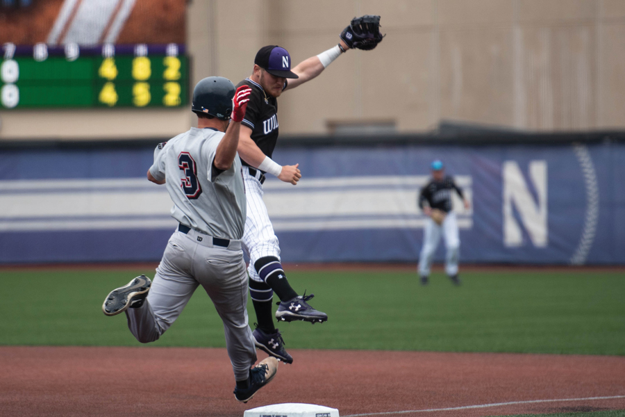 Northwestern first baseman Willie Bourbon and Belmont baserunner Ben Kocher stretch to tag the base first. Kocher's Bruins took two of three games from the Wildcats in the weekend series.