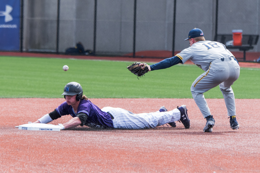 Jack Dunn slides in safely to second base. The junior shortstop walked off Friday's win against Iowa.