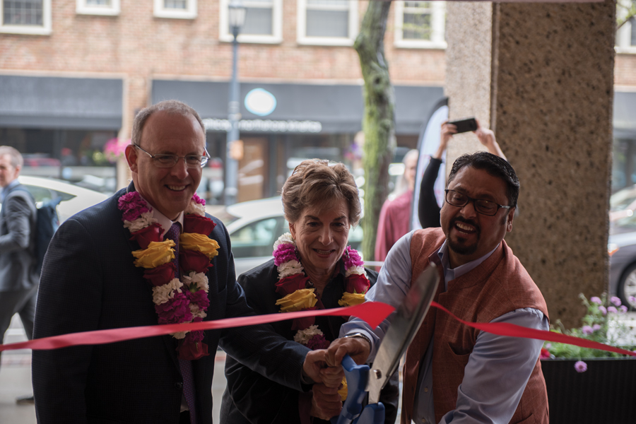 U.S. Rep. Jan Schakowsky (D-Ill.) (middle), Steve Hagerty (left) and Ramakant Kharel (right) cut a ribbon at Red Hot Chilli Pepper, 500 Davis St. At the ceremony, guests were served a buffet lunch and watched a dance performance by Northwestern Bhangra.